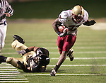4 November 2006: Boston College's Andre Callender (32) slips out of the tackle of Wake Forest's Stanley Arnoux (43) for a good gain up the sideline. Wake Forest defeated Boston College 21-14 at Groves Stadium in Winston-Salem, North Carolina in an Atlantic Coast Conference college football game.