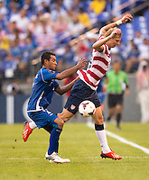 Brek Shea (23) of the United States is fouled by Xavier Garcia Orellana (2) of El Salvador during the quarterfinals of the CONCACAF Gold Cup at M&T Bank Stadium in Baltimore, MD.  The United States defeated El Salvador, 5-1.