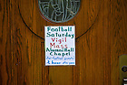 Aug. 30, 2014; Sign for vigil Mass outside Alumni Hall chapel..Photo by Matt Cashore/University of Notre Dame