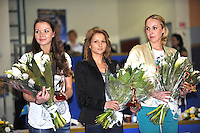 (L-R) Olympians Dinara Gimatova of Azerbaijan, Simona Peycheva of Bulgaria and Inna Zhukova of Belarus smile during special presentation before Event Finals awards at Holon Grand Prix, Israel on March 5, 2011.  (Photo by Tom Theobald).