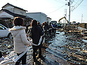 Residents of Wakabayashi-ku, Sendai, Miyagi Prefecture Holding Fire Hose on March 12th, 2011. A huge M8.9 earthquake hit Japan on Friday 11th March, 2011 followed by a giant tsunami causing death and destruction