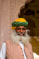 Man in an ornate doorway, Mehrangarh Fort, Jodhpur, Rajasthan, India
