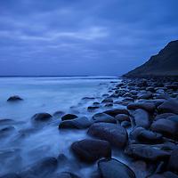 Coastal rocks in water at Unstad beach, Vestvågøy, Lofoten Islands, Norway