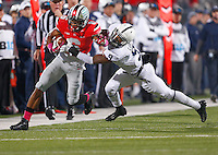 Ohio State Buckeyes wide receiver Evan Spencer (6) shakes off Penn State Nittany Lions cornerback Jordan Lucas (9) for a gain in the second quarter at Ohio Stadium on October 26, 2013.  (Chris Russell/Dispatch Photo)