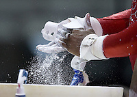 Kyla Ross of Gym-Max applies chalk on her hands before competing on the uneven bears during the 2012 US Olympic Trials competition at HP Pavilion in San Jose, California on June 29th, 2012.