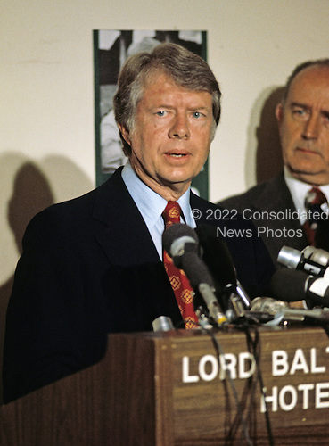 Governor Jimmy Carter (Democrat of Georgia) a candidate for the 1976 Democratic nomination for President of the United States, makes a campaign appearance in Baltimore, Maryland on May 13, 1976.  Standing at right is Mayor William Donald Schaefer (Democrat of Baltimore).<br /> Credit: Arnie Sachs / CNP