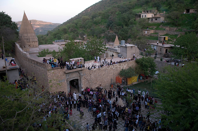 LALISH VALLEY, IRAQ: Yezidis stand around the Lalish Temple as they wait for the sun to set to begin their New Year's celebration...The Yezidis, a minority religious group found in northern Iraq, celebrate Chwar Shema Sur (Red Thursday), as part of their New Year festival.  The Yezidis are the religious descendants of Zoroastrians and as a religious minority in Iraq are often targeted by terrorists.