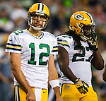 Green Bay Packers quarterback Aaron Rodgers (12) looks at the scoreboard after a timeout was called against the Seattle Seahawks in the third quarter of the NFL Kickoff held at CenturyLink Field  September 4, 2014 in Seattle. Rodgers was sacked three times, once for a safety and passed for 189 yards for one touchdown and one interception. The Seahawks beat the Packers 36-16.  .  Seattle beat Green Bay 36-16. ©2014  Jim Bryant Photo. ALL RIGHTS RESERVED.