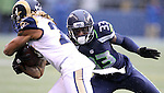 Seattle Seahawks safety Kelcie McCray (33) moves in to tackle St. Louis Rams running back Tre Mason (27) at CenturyLink Field in Seattle, Washington on December 27, 2015.  The Rams beat the Seahawks 23-17.      ©2015. Jim Bryant Photo. All Rights Reserved