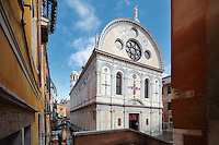 Church of Santa Maria dei Miracoli, built 1481-89 by Pietro Lombardo in Renaissance style, to house a miraculous icon of the Virgin Mary, Venice, Italy. The early Venetian Renaissance facade has a false arcade design of coloured marble, which was restored 1987-97. The city of Venice is an archipelago of 117 small islands separated by canals and linked by bridges, in the Venetian Lagoon. The historical centre of Venice is listed as a UNESCO World Heritage Site. Picture by Manuel Cohen
