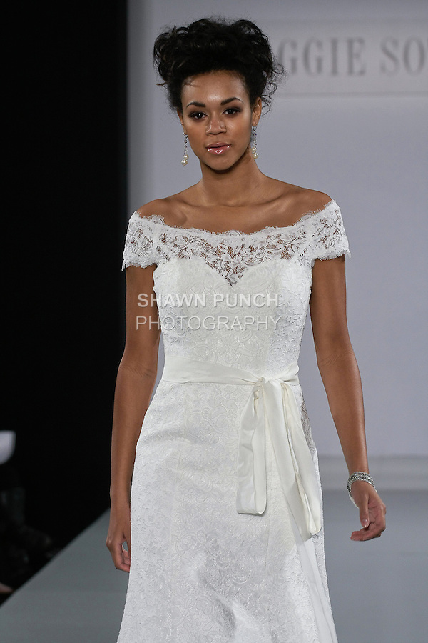 Model walks runway in an Amara wedding dress from the Sottero and Midgley Spring 2013 collection, at The Couture Show, during New York Bridal Fashion Week, on October 14, 2012.