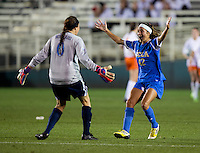 Ally Courtnall (42) of UCLA celebrates her goal with teammate Katelyn Rowland (0) during the Women's College Cup semifinals at WakeMed Soccer Park in Cary, NC. UCLA advance on penalty kicks after typing Virginia, 1-1 in regulation time.