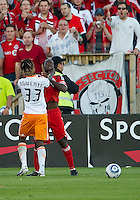 01 July 2010:  Houston Dynamo forward Joseph Ngwenya #33 grabs Toronto FC defender Nana Attakora #3 by the neck during a game between the Houston Dynamo and the Toronto FC at BMO Field in Toronto..Final score was 1-1....