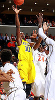 CHARLOTTESVILLE, VA- NOVEMBER 29: Tim Hardaway Jr. #10 of the Michigan Wolverines shoots between Virginia Cavalier defenders during the game on November 29, 2011 at the John Paul Jones Arena in Charlottesville, Virginia. Virginia defeated Michigan 70-58. (Photo by Andrew Shurtleff/Getty Images) *** Local Caption *** Tim Hardaway Jr.