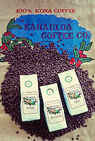 Packages of Kona coffee resting on coffee beans, resting on Kahauloa Coffee Co. bag, Kealakekua