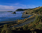 Cape Sebastian State Park Southern Oregon Coast Highway 101 at sunset looking north from viewpoint above coastline with rock formations and beach with highway Oregon State USA