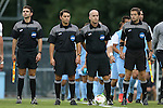12 September 2014: Match officials. From left: Assistant referee Jeremy Smith,  fourth official Ben Meyer, referee Mike Stuff, and assistant referee Ben Wooten. The University of North Carolina Tar Heels hosted the Pittsburgh University Panthers at Fetzer Field in Chapel Hill, NC in a 2014 NCAA Division I Men's Soccer match. North Carolina won the game 3-0.
