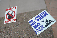 Phoenix, Arizona. June 25, 2012 - Signs like these opposing Maricopa County Sheriff  Arpaio and police racism were used during the protest against the U.S. Supreme Court ruling on Arizona law for upholding SB 1070's provision that advocacy groups say will promote racial profiling. Immigrant rights groups protested the United States Supreme Court ruling on Arizona law for upholding SB 1070's provision that will allow police to demand papers if there's reasonable suspicion that a person may be illegally in the country. Photo by Eduardo Barraza © 2012