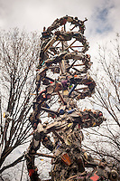 "Detail of ""DNA Totem"" by the artist Suprina Kenney in Marcus Garvey (Mount Morris) Park in Harlem in New York on Saturday, April 2, 2016. The 9-foot tall public sculpture represents a strand of DNA and is made of steel in which the artist has embedded discarded objects that she has found on the streets. The sculpture will be on view until September 30, 2016.  (© Richard B. Levine)"