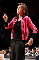 CHARLOTTESVILLE, VA- December 7: Head coach Joanne Boyle of the Virginia Cavaliers coaches her team during the game against the Liberty Lady Flames on December 7, 2011 at the John Paul Jones arena in Charlottesville, Va. Virginia defeated Liberty 64-38. (Photo by Andrew Shurtleff/Getty Images) *** Local Caption *** Joanne Boyle