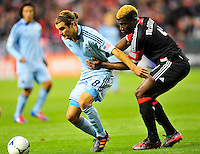 Graham Zusi of Sporting KC's is held by United's Brandon McDonald. Sporting Kansas City defeated D.C. United 1-0 during an MLS home opener at the RFK Stadium in Washington, D.C. on Saturday, March 10, 2012. Alan P. Santos/DC Sports Box