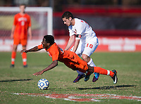Austin Stewart (23) of Virginia Tech is fouled by Nazmi Albadawi (10) of North Carolina State during the game at Ludwig Field in College Park, MD. Virginia Tech defeated North Carolina State, 3-2, in the ACC tournament play-in game.