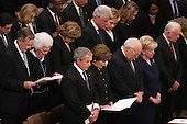 Dignitaries in the front rows at the State Funeral for former United States President Gerald R. Ford at the Washington National Cathedral, in Washington, D.C. on Tuesday, January 2, 2006.  In the front row are: President George W. Bush,first lady Laura Bush,Vice President Dick Cheney, Lynne Cheney, and former President Jimmy Carter.  In the second row are former President George H.W. Bush, former first lady Barbara Bush, Doro Bush Koch, former President Bill Clinton, former first lady Senator Hillary Rodham Clinton (Democrat of New York), Chelsea Clinton, Secretary of State Condoleezza Rice..Credit: Ron Sachs / CNP.[NOTE: No New York Metro or other Newspapers within a 75 mile radius of New York City].