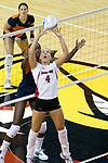 26 Aug 2005<br /> <br /> Redbird Erin Lindsey sets the ball as Illini Vicki Brown (near net) sets up in anticipation. <br /> <br /> The Illini beat the Redbirds in the seasons opener for both team in 5 games 30-24, 30-19, 23-30, 30-21, 15-11.  Redbird Areana, Illinios State University, Normal, IL