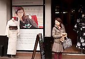 A young Japanese lady in front of a young women's kimono store in trendy Sakae of Nagoya city.