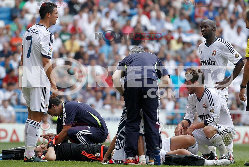 Real Madrid's Iker Casillas (b) and Pepe (d) injured in presence of Cristiano Ronaldo (l), Sergio Ramos (c) and Lass Diarra (r) during La Liga match.August 19,2012. (ALTERPHOTOS/Acero) /NortePhoto.com<br /> <br />  **CREDITO*OBLIGATORIO** *No*Venta*A*Terceros*<br /> *No*Sale*So*third* ***No*Se*Permite*Hacer Archivo***No*Sale*So*third*