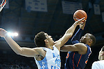 16 February 2013: Virginia's Akil Mitchell (right) shoots over North Carolina's James Michael McAdoo (43). The University of North Carolina Tar Heels played the University of Virginia Cavaliers at the Dean E. Smith Center in Chapel Hill, North Carolina in a 2012-2013 NCAA Division I and Atlantic Coast Conference men's college basketball game. UNC won the game 93-81.