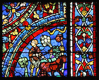 The older son at work in the fields with his oxen, looking jealously towards the scene of his father giving the inheritance to his brother, from the Parable of the Prodigal Son stained glass window, in the north transept of Chartres Cathedral, Eure-et-Loir, France. This window follows the parable as told by St Luke in his gospel. It is thought to have been donated by courtesans, who feature in 11 of the 30 sections. Chartres cathedral was built 1194-1250 and is a fine example of Gothic architecture. Most of its windows date from 1205-40 although a few earlier 12th century examples are also intact. It was declared a UNESCO World Heritage Site in 1979. Picture by Manuel Cohen