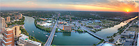 From high above the Austin skyline, this Austin panorama was captured by blending several images together to create the pano. The sun was setting in the southwest over Ladybird Lake, Zilker Park, and Auditorium Shores. From 54 floors up, this is the amazing view you have. The Congress and First Street Bridges are in the forefront of the photograph, and there was a music festival taking place along the waterfront just across the river. To the east you can see I-35 heading to San Antonio.