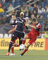 Chicago Fire midfielder Logan Pause (12) attempts to control the ball as New England Revolution forward Saer Sene (39) closes. In a Major League Soccer (MLS) match, the New England Revolution defeated Chicago Fire, 2-0, at Gillette Stadium on June 2, 2012.