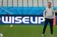 England manager Roy Hodgson next to an advertisement board saying 'Wise Up' during training ahead of tomorrow's Group D match vs Uruguay