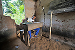 Luambo Dimange stays after class to do his homework in a United Methodist-sponsored school in the Congolese village of Tunda.