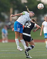 Boston Breakers midfielder Leslie Osborne (12) battles for a head ball. In a Women's Premier Soccer League Elite (WPSL) match, the Boston Breakers defeated New England Mutiny, 4-2, at Dilboy Stadium on June 20, 2012.