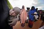 A child observes the world from its mother's side in the Dadaab refugee camp in northeastern Kenya. Tens of thousands of newly arrived Somalis who have swelled the population of what was already the world's largest refugee camp.