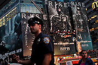 A New York Police Department officer patrols the streets of Times Square after NYPD increased security at movie theaters after 'Dark Knight Rises' premier in New York, July 20, 2012.  Photo by Eduardo Munoz Alvarez / VIEW.
