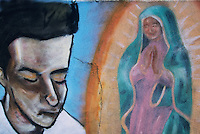 A mural on a fractured wall along Agua Fria Road in Santa Fe, New Mexico, evokes the sense of personal relationship that many feel with the  Virgin of Guadalupe