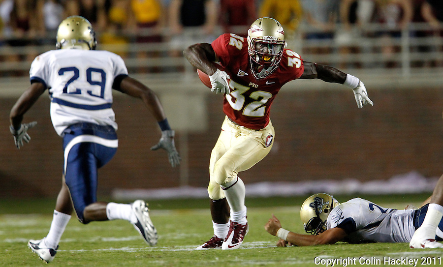 TALLAHASSEE, FL 10-FSU-CSU091011 CH-Florida State's James Wilder, Jr. leaves Charleston Southern's Zac Johnston, right, in his dust as he runs down field toward Southern's Marquiz Hodo during second half action Saturday at Doak Campbell Stadium in Tallahassee. The Seminoles beat the Buccaneers 62-10..COLIN HACKLEY PHOTO