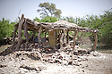 A home is barely left standing after water flooded Pakistan. One month after the devastating monsoon rains caused huge floods in Pakistan, new areas are still affected and water still stands among fields and houses. Jamshoro, Pakistan, 2010