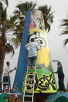 (left to right) Graffiti artists Think, 25, Sober, 19, and Draw, 19, paint the chimney at Venice Beach during the Paintout Festival on Sunday, June 3, 2007. The day-long event was geared toward joining the artistic community and Venice Beach residents in a cooperative effort to encourage creativity and support the Public Arts Walls