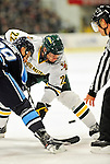 30 October 2010: University of Vermont Catamount forward Josh Burrows, a Senior from  Prairie Grove, IL, takes a faceoff against the University of Maine Black Bears' forward Tanner House at Gutterson Fieldhouse in Burlington, Vermont. The Black Bears defeated the Catamounts 3-2 in sudden death overtime. Mandatory Credit: Ed Wolfstein Photo