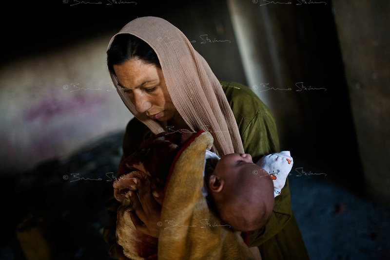 Attatra, Gaza Strip, Jan 21 2009.Showk Al Attar, 29 with her nephew, Mohanad, just 40 days old.Twenty-six members of the Al Attar family have to live in their burned down home, without windows, furniture, beds or clothes...
