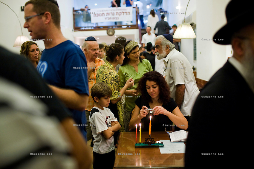 Dina Evioni (4th from right) and Eli Evioni (2nd from right) talk amongst the community at Chabad Bangkok (Khao San road), Thailand during Chanuka celebrations on 12th December 2009. (ref: portraits of Eli and Dina for more details).Photo by Suzanne Lee / For Chabad Lubavitch