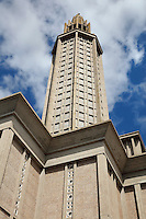 Looking up at the tower of Eglise Saint-Joseph or St Joseph's Church, built 1951-58 as a memorial to the 5000 citizens of the town who died during the Second World War, designed by Auguste Perret, 1874-1954, and Raymond Audigier, Le Havre, Normandy, France. The church is built from pre-cast concrete, with tall thin stained glass windows by Marguerite Hure, a Neo-Gothic interior and a 107m tall tower which acts as a beacon from out at sea. Perret was mentor to Le Corbusier and specialised in the use of concrete. He led the reconstruction of Le Havre in the 1950s, after the town was completely destroyed in WWII. The centre of Le Havre is listed as a UNESCO World Heritage Site. Picture by Manuel Cohen