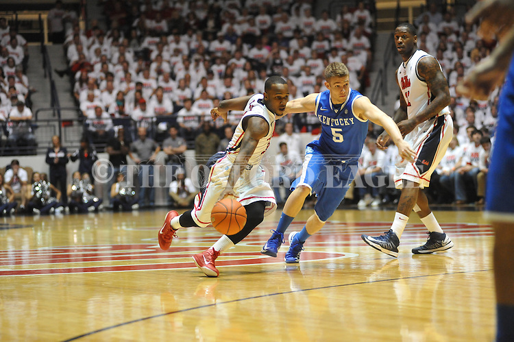 Ole Miss' Derrick Millinghaus (3) vs. Kentucky's Jarrod Polson (5) at the C.M. &quot;Tad&quot; Smith Coliseum on Tuesday, January 29, 2013.  (AP Photo/Oxford Eagle, Bruce Newman)..
