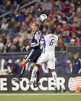 New England Revolution forward Ilija Stolica (9) and Kansas City Wizards defender Shavar Thomas (6) battle for head ball. The New England Revolution defeated Kansas City Wizards, 1-0, at Gillette Stadium on October 16, 2010.