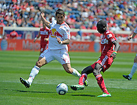 New York defender Carlos Mendes (44) defends against Chicago forward Dominic Oduro (8).  The Chicago Fire tied the New York Red Bulls 1-1 at Toyota Park in Bridgeview, IL on June 26, 2011.
